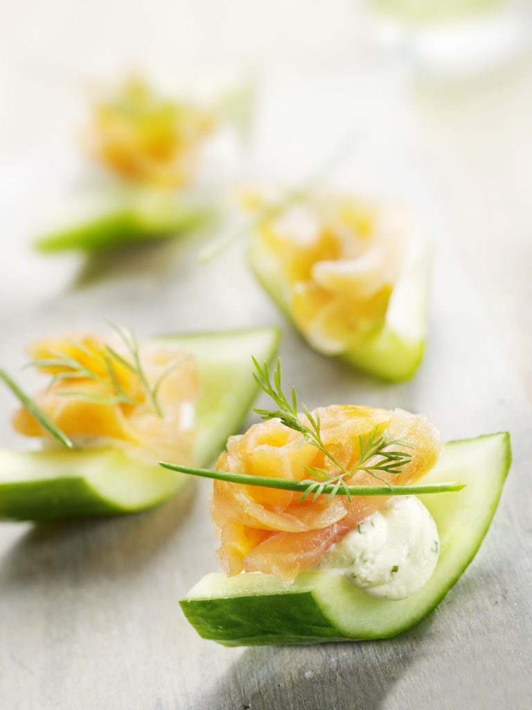 Cucumber slices topped with smoked salmon, cream, cheese, dill, and lemon zest. A great party appetizer!