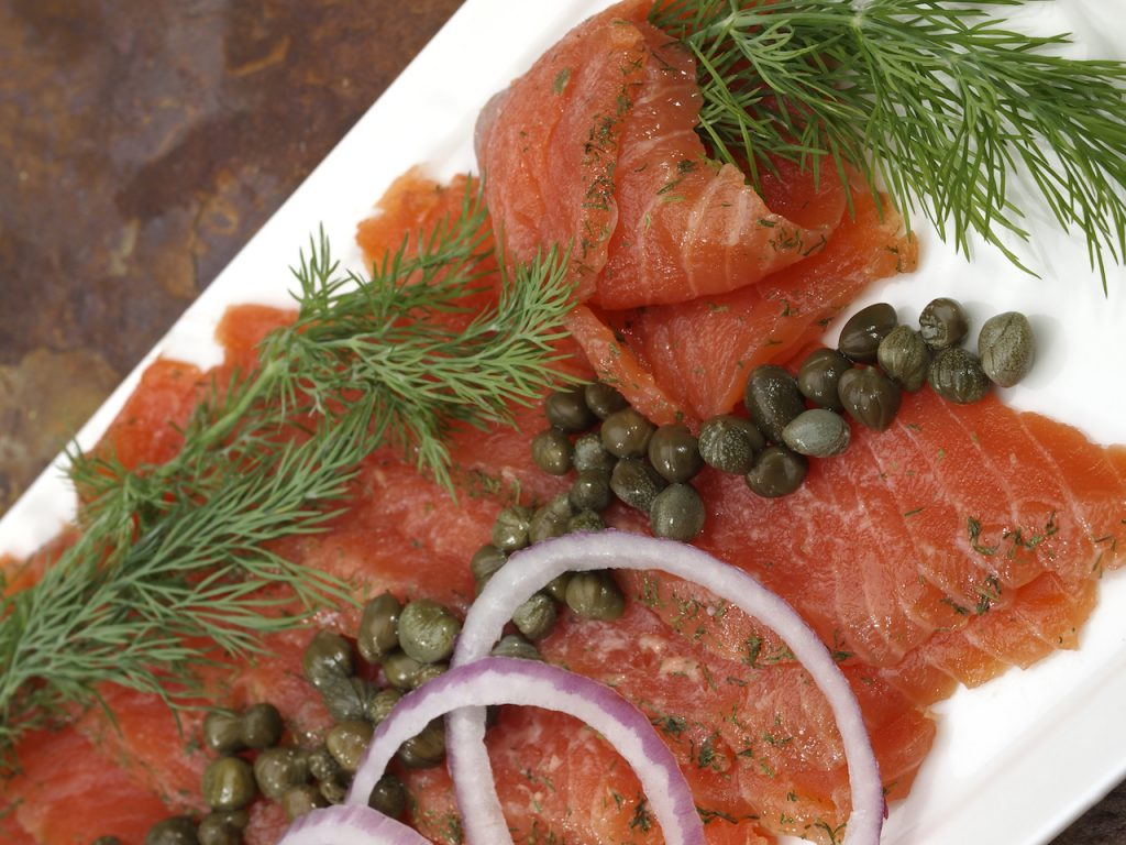 Scandinavian Salt and Sugar cured salmon platter with fresh dill, red onion and capers