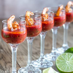 Shrimp cocktail with bloody caesar dipping sauce made with clam juice, ketchup, black pepper, Worcestershire, Tabasco, lemon, horseradish.