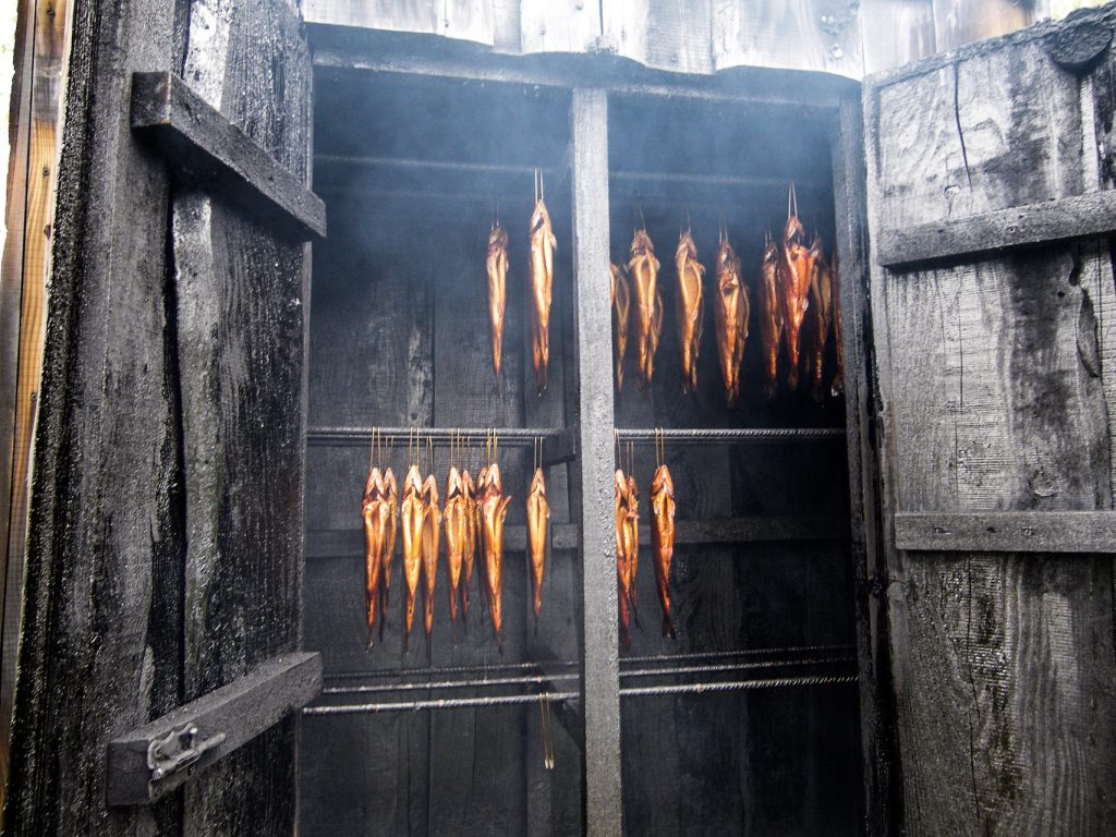 Fish being smoked at a traditional Norwegian smokehouse.