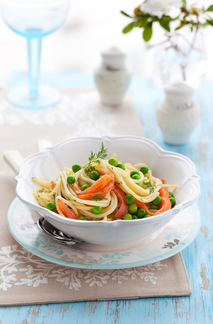 Smoked salmon pasta with garlic, olive oil, smoked salmon, peas, white wine, cream, lemon, and dill.