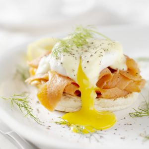 Eggs Benedict with poached eggs, smoked salmon, hollandaise, and an English muffin. Perfect for brunch or a weekend breakfast