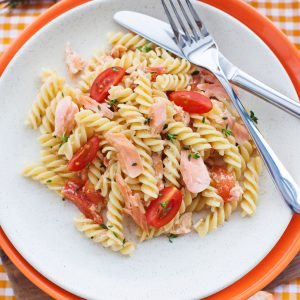 Pasta salad with smoked salmon, dill, lemon, sour cream, veggies of choice such as cherry tomatoes, peas, bell pepper, and red onion.