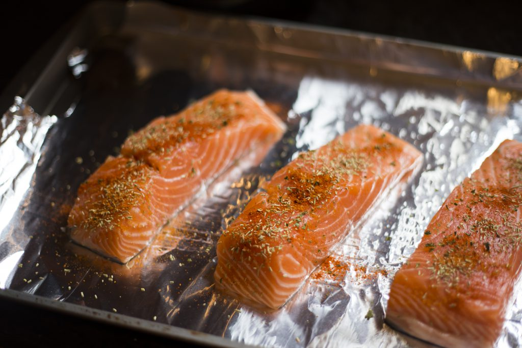 Salmon being baked in the oven.