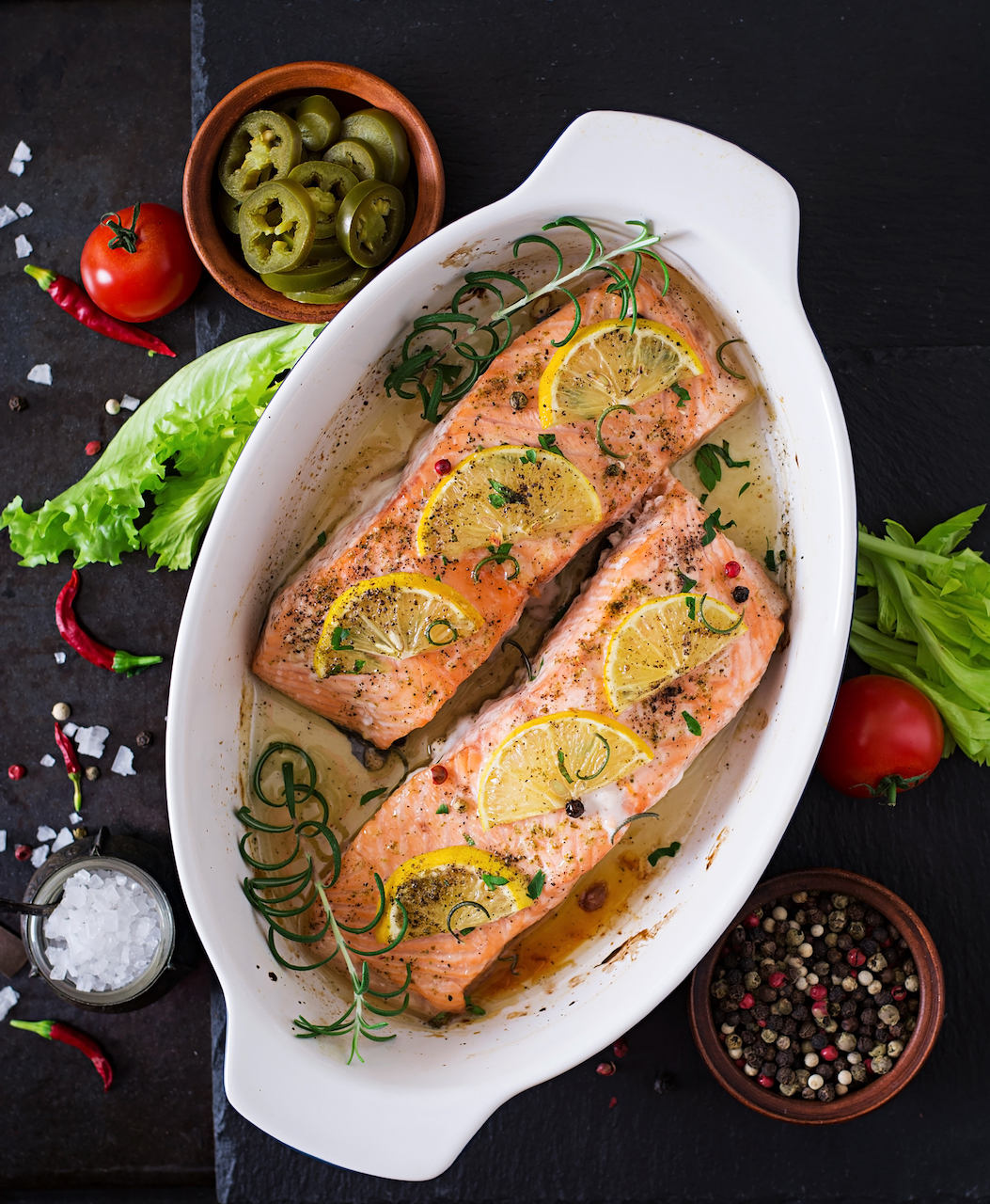 Salmon baked with lemon, herbs, and olive oil.
