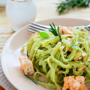 Salmon pasta with fresh pesto and lemon.