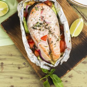 Oven baked salmon with vegetables in a foil pack. Perfect for the grill or in the oven.