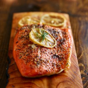 DOM Reserve salmon cooked on a cedar plank with lemon