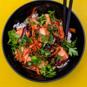 Roasted salmon, sliced bell pepper, red onion, chives, steamed rice, cilantro or parsley, and teriyaki glaze or soy sauce.