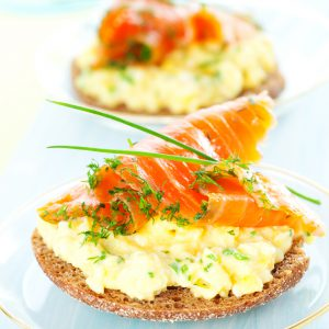 Smoked Salmon Breakfast Sandwich with chives and scrambled eggs